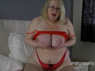 Sally playing with a huge black dildo